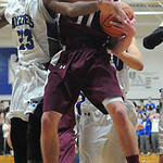 Wellington's Dylan Kidd and Midview's Daimion Mahone go up for rebound. STEVE MANHEIM/CHRONICLE
