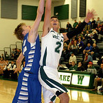 Westlake's Anthony Trujillo and Bay's Alec White fight for the rebound. LINDA MURPHY/CHRONICLE