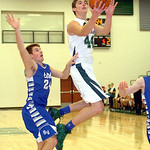 Westlake's Gavin Skelly drives past Bay's Collin DeBarr for a basket. LINDA MURPHY/CHRONICLE