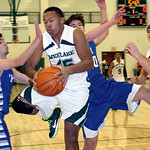 Westlake's Cameron Brown fights Bay's Brandon Morriss for the rebound. LINDA MURPHY/CHRONICLE