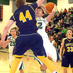 Westlake's Anthony Trujillo tries to shoot past North Ridgeville's Nathan Colbert. LINDA MURPHY/CHRONICLE