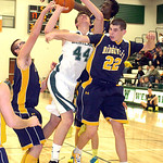 North Ridgeville's Nolan Freeman, left, Demario McCalland Dennis Millgard block Westlake's Gavin Skelly. LINDA MURPHY/CHRONICLE