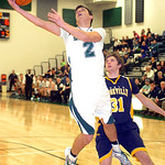 Westlake's Anthony Trujillo drives past North Ridgeville's Tyler Arnold. LINDA MURPHY/CHRONICLE
