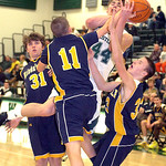 Westlake's Gavin Skelly is blocked by a trio of North Ridgeville defenders, including Tyler Arnold, left, and Chad Kisel, center. LINDA MURPHY/CHRONICLE