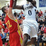 Lorain Louis Cheers is fouled going to hoop by Brecksville Matt Csuhran in first half Mar. 6.  Steve Manheim