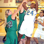 Clearview&#039;s #24 Desiree Ray tries to shoot past Columbia&#039;s #42 Kaley Marshall and #3 Christine Lyzen.