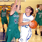 Clearview's #32 Raquel Santana works her way around Columbia's #42 Kaley Marshall.