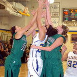 Columbia's #10 Emily Viccarone and #3 Christine Lyzen fight Clearview's #20 Sydney Wright for the rebound.
