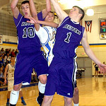 Keystone's #10 Matt Bastock and #1 C.J. Conrad fight Clearview's #21 Daimon Knowles for the rebound.