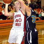 Lutheran West&#039;s #40 Amanda Stephens works to shoot past Clearview&#039;s #32 Raquel Santana