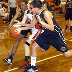 Clearview&#039;s #24 Desiree Ray and #32 Raquel Santana fight Lutheran West&#039;s #44 Olivia Vasiloff for the ball.
