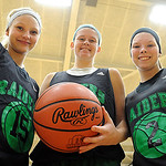 Kaley Marshall, left, Christine Lyzen and Jenna Guth of Columbia basketball get ready for the new season on Nov. 21.   Steve Manheim