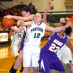 Avon's #33 and #23 Brianna Smith fight EC's #12 Riley Schill for the rebound.