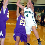 EC's #4 Josie Carandang shoots past Avon's #33 and #23 Brianna Smith.