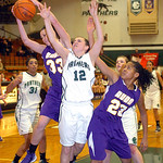 Avon's #33 (not on roster) and #23 Brianna Smith fight EC's #12 Riley Schill for the rebound.