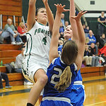 EC Josie Carandang puts ball up over Bay 22 Claire Werbiak and Emma Grubaugh in first half Feb.13.  Steve Manheim