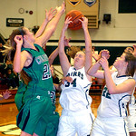 EC's #34 Erin Herschelman fights to keep the rebound from Columbia's #20 Amy Mirecki.