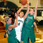 EC's #4 Josie Carandang shoots past Columbia's #42 Kaley Marshall and #3 Christine Lyzen.