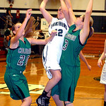 EC's #12 Riley Schill shoots past Columbia's #20 Amy Mirecki and #3 Christine Lyzen.