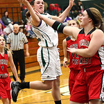 Riley Schill of EC is fouled by Carey Smith of Lutheran West. photo by Ray Riedel