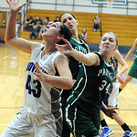 Midview 43 Paige Surman grabs a rebound away from EC 34 Erin Herschelman and Julia Scarpelli in first half Dec. 5.  Steve Manheim