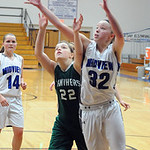 EC 22 Shannon Hopkins and Midview Molly Linn go up for rebound Dec. 4.  Steve Manheim