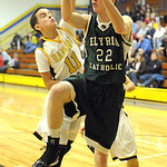 EC Daniel Whitacre has ball blocked by North Ridgeville Tyler DeShetler Dec. 18.  Steve Manheim