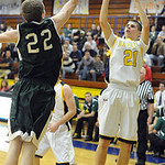 North Ridgeville Dennis Millgard shot over EC Daniel Whitacre Dec. 18.   Steve Manheim
