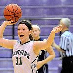 Elyria Catholic's Brittney McNamara celebrates after the Lady Panther's win over Rootstown. DAVID RICHARD  CHRONICLE