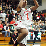 Elyria Sybil Roseboro goes to hoop in second half of Div. I district Feb. 27. Steve Manheim