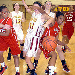 Elyria's #1 Sybil Roseboro fights Avon Lake's #11 Anelise Kollias for the ball.