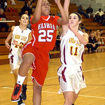 Elyria's #25 Jocelyn Spraggins goes for a basket past Avon Lake's #11 Anelise Kollias.