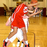 Elyria's #43 Mariah Johnson fights Avon Lake's #25 Molly Disbrow for the ball.