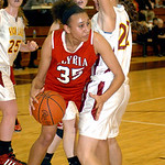 Elyria&#039;s #35 Alexis Middlebrooks tries to move around Avon Lake&#039;s #22 Maggie Heschel.