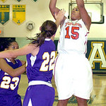 Elyria's #15 Mary Jones shoots past Avon's #22 Brianna Conroy and #23 Brianna Smith.