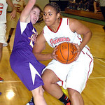 Elyria's #15 Mary Jones works around Avon's #15 Catie Kelly.