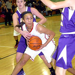 Elyria's #35 Alexis Middlebrooks works around Avon's #33 Alexandra Bjorn.