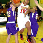 Elyria's #15 Mary Jones leaps to shoot past Avon's #22 Brianna Conroy and #23 Brianna Smith.