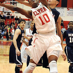Elyria Isaiah Walton battles for rebound with Berea Derrick Hail in second half Dec. 4.  Steve Manheim