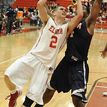 Elyria Kody Bender is fouled going to basket by Berea Devin Posey in fourth quarter Dec. 4. Steve Manheim