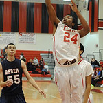 Elyria AJ Johnson goes to basket by Berea 55 Derrick Hall in second half Dec. 4.  Steve Manheim