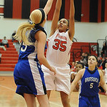 Elyria Alexis Middlebrooks takes shot over Brunswick Gabrielle Bulic Dec. 12. Steve Manheim