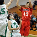 Elyria Jarred Schultz puts shot up over Mayfield Alex LoPiccolo, front, and Matt Flowers Dec. 13.  Steve Manheim