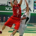 Elyria Kody Bender goes to hoop over Mayfield Brook Krajcirik in first half Dec. 13.  Steve Manheim