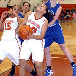Midview's #32 Molly Linn tries to block Elyria's #10 Shayla Middlebrooks from shooting. Elyria's #15 is Mary Jones.