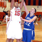 Elyria's #15 Mary Jones shoots past Midview's #32 Molly Linn.