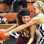 Shayla Middlebrooks, left, of Elyria tries to dribble around Jessica Koch in overtime. DAVID RICHARD / CHRONICLE