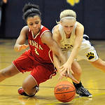 Sybil Roseboro, left, of Elyria reaches for a loose ball against Olmsted Falls' Jessica Koch in the fourth quarter. DAVID RICHARD / CHRONICLE