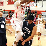 Elyria Isaiah Walton puts up shot over Valley Forge Adam Hanych Dec. 18.  Steve Manheim