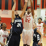 Elyria 22 Trenell Oliver and Valley Forge Adam Hanych go up for rebound dec. 18.  Steve Manheim
